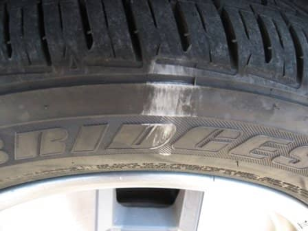 The outer front tire has scuffed all of the shoulder grooves, and the car wasn't even leaning. It needs more air.