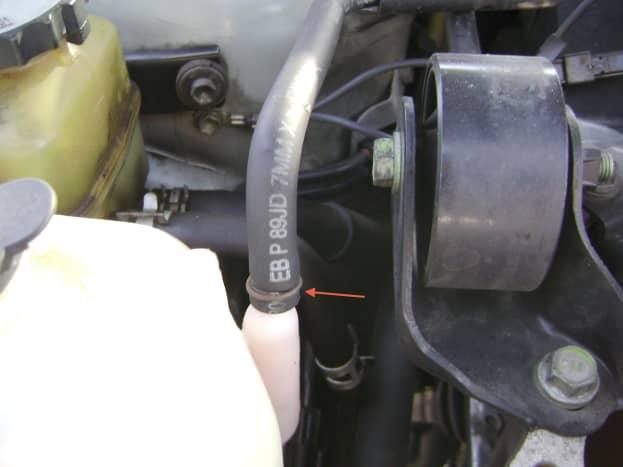 P.  Disconnect the coolant reservoir hose.