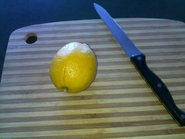 Cut a lemon in half.