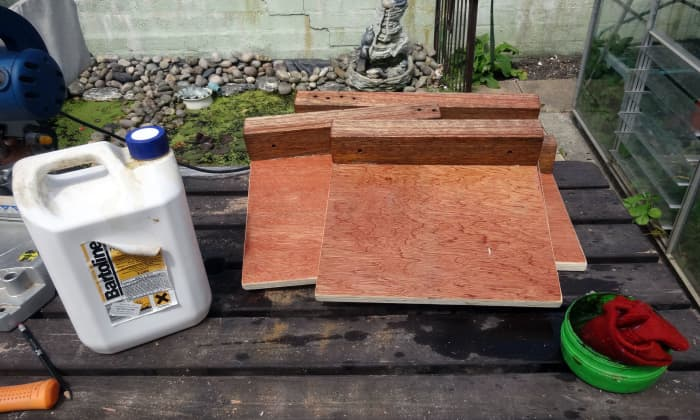 Teak oil rubbed into underside of the platforms prior to upholstering.