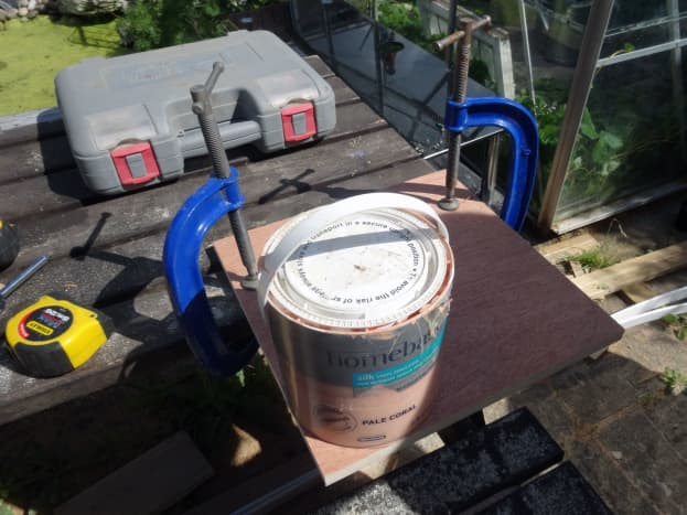 Paint pot used as guide to mark curved corners, ready for cutting with a jig saw.