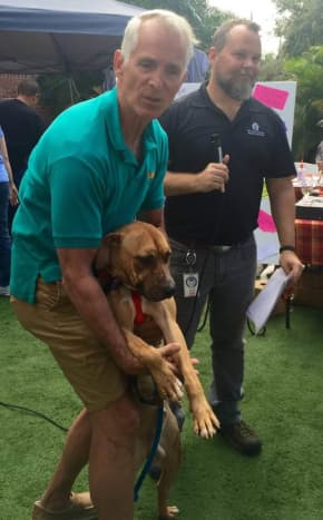 Valuable volunteer with just one of the adoptable dogs from MCAS