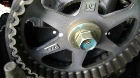 Camshaft pulley TDC alignment paint marks.