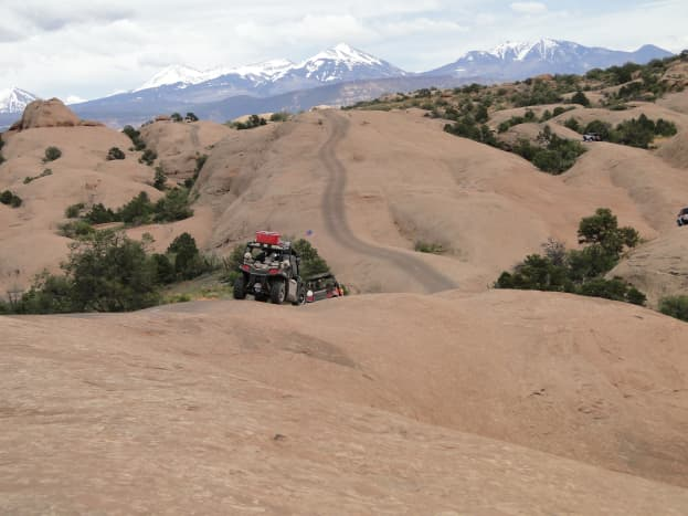 Going up and down the trail worn into the rock from UTV tires.