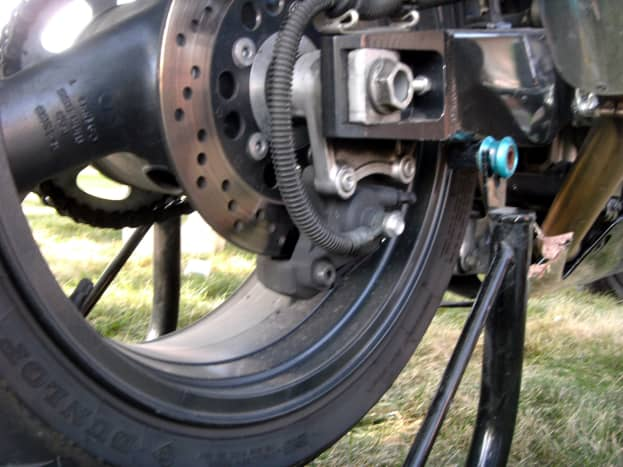 Location of the rear caliper on the bottom of the brake rotor.
