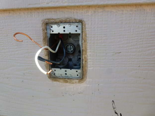 Wire is pulled into the new box, ready for the outlet.