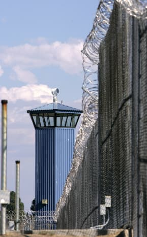 Guard tower and fence with razor wire