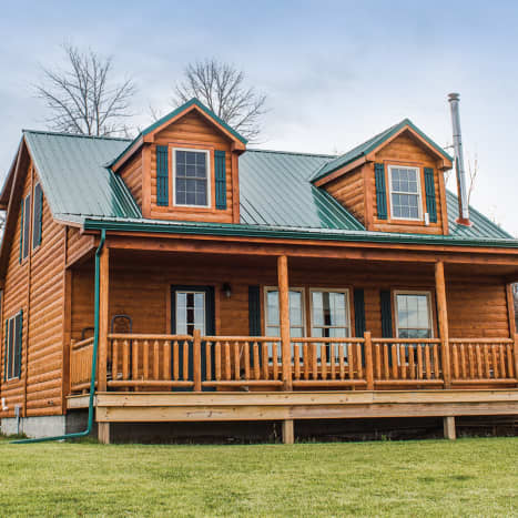 The Homestead features a large second story with loft, and two gabled dormers. Invoking Cape Cod, this full-featured but rustic design starts at $231,174 for a 3-bed, 2-bath design.