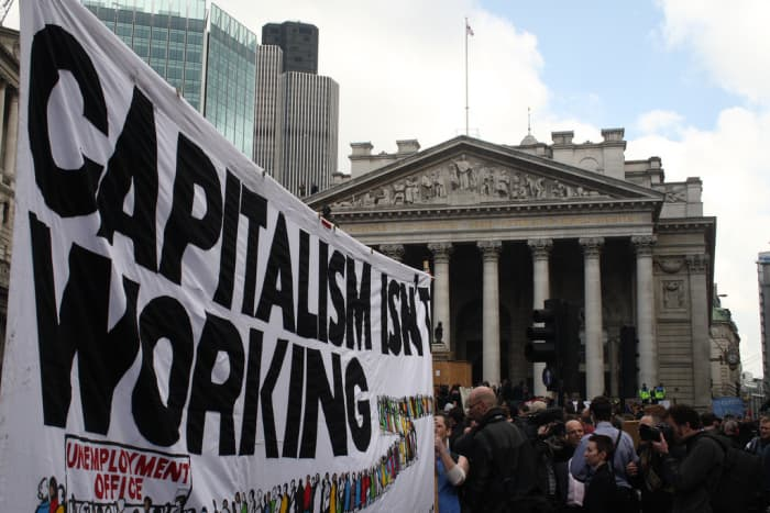"""A banner reading """"Capitalism isn't working"""" (a pun on the Conservative election poster """"Labour isn't working"""") at the G20 Meltdown protest in London on April 1, 2009."""