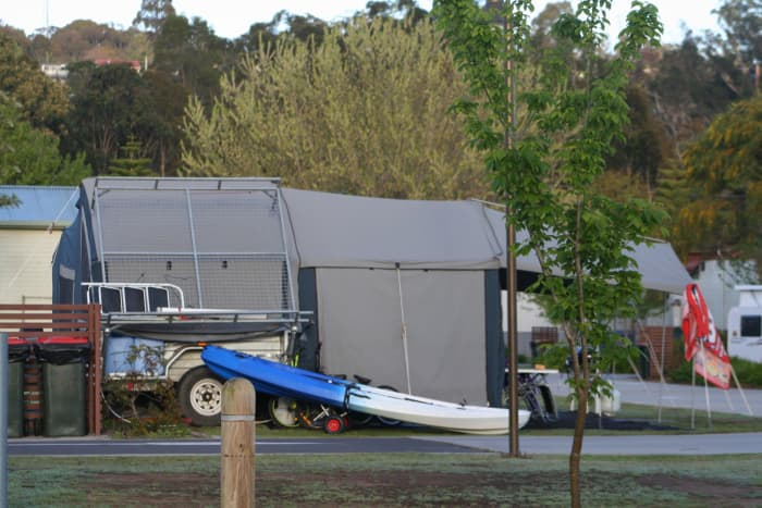 The first time I saw a tent trailer erected, I was amazed by its size and space. See the tiny trailer buried within this large tent? These are a lot cheaper than you'd expect.