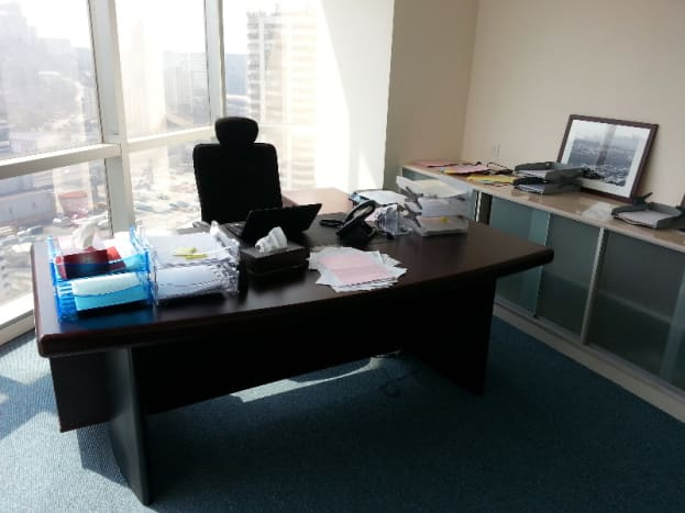 One of the exciting photo stream photos from PT's website, showing off how confident you should be investing $4100 because they have a photo of an office with a desk in it.
