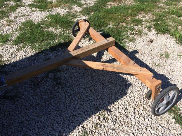 This DIY rake has detachable wheels for transfer, taken from a bike trailer.
