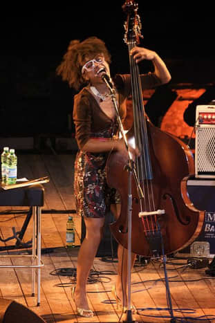 Esperanza Spalding quite often alternates between upright bass and bass guitar.