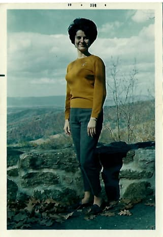 Never a hippie, my mother models a 1960s bouffant and more conservative styles of the era.