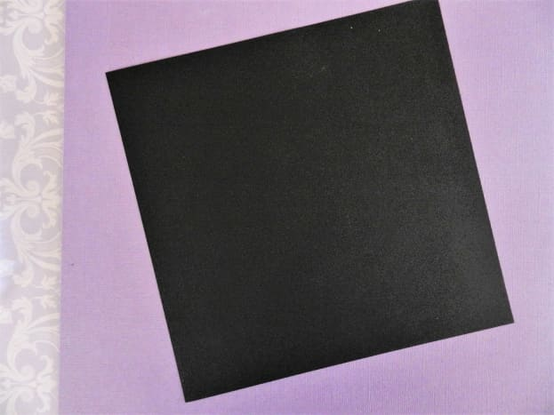 Start with a perfect square in black, brown, or gray paper.