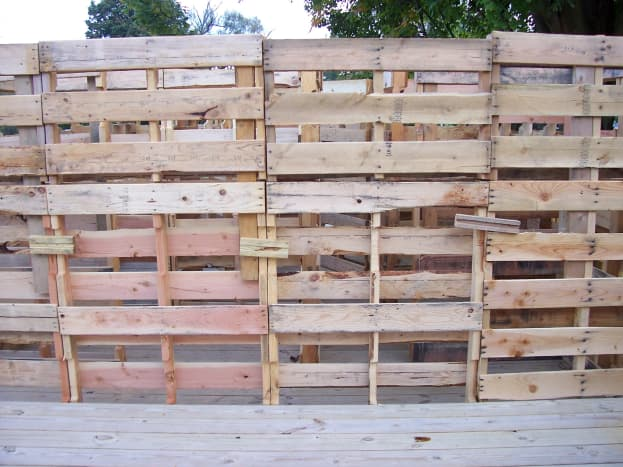 Our 2014 maze used wooden pallets for the walls. They were fastened together with 2.5'' nails. We nailed the pallets directly together and nailed small wooden pieces to join them. These were then covered in cardboard and black plastic.