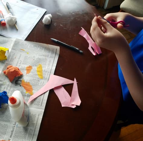 Cut out bunny ears from pink construction paper.