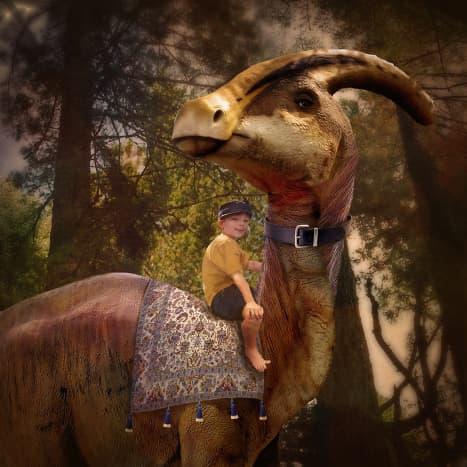 My nephew riding a dinosaur