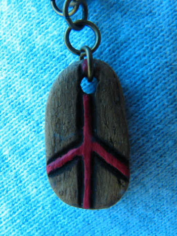 I attached jump rings to this pendant and promptly turned the piece in to a charm for a bracelet.