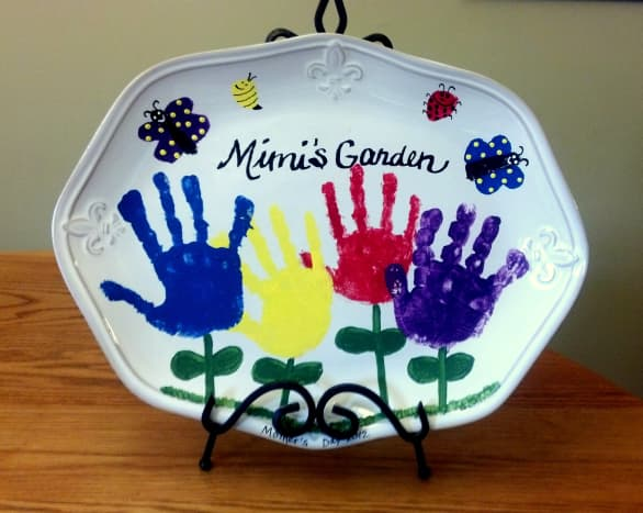 Our finished handprint garden displayed on an easel.