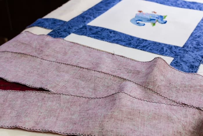 Cut and overlock the remaining frame strips.