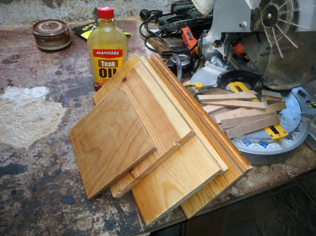 Wood ready for assembly including the two side panels, original top and bottom piece