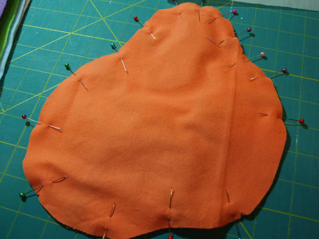 1. Pin the front of the body to the back, right sides together.