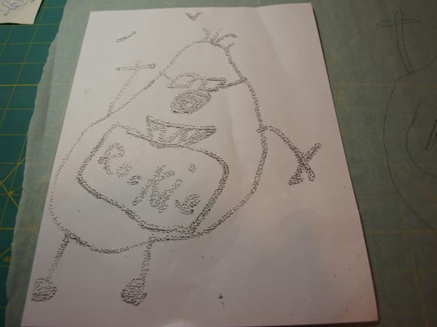 1. Using a copier, enlarge the drawing as much as possible.  The original doodle is about 3 inches high.