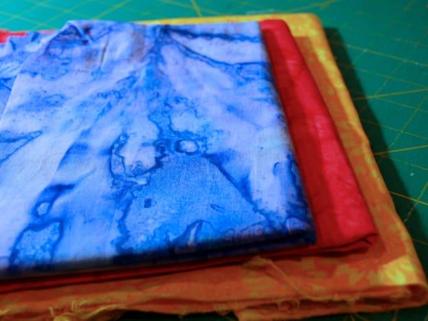 Bright fabrics give the mug rug a summer like feel.