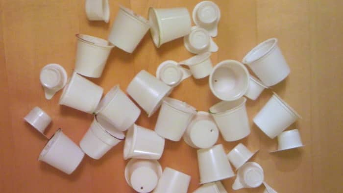 A jumble of clean K-cups and Mini Moo containers will make lovely Barbie hats