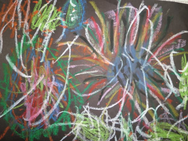 Fireworks art done with oil pastel on black construction paper.