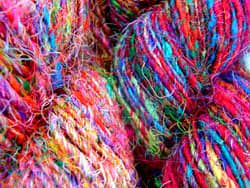 Silk sari yarn is brilliantly coloured, thin and very flexible. This is the preferred yarn for knitting and crochet projects.