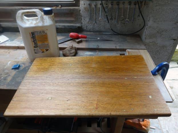 Applying teak oil to the table top