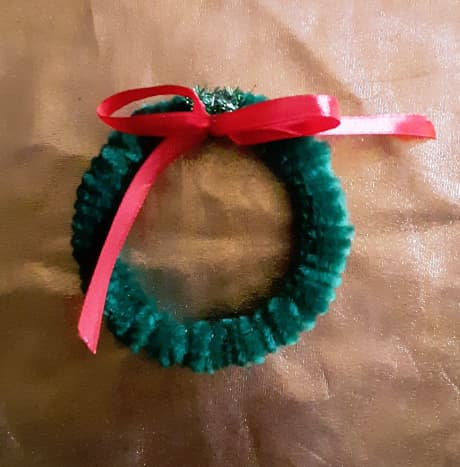 Add a little bow on wreath.