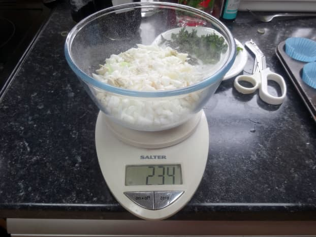 Weighing the chopped soap bits being recycled.
