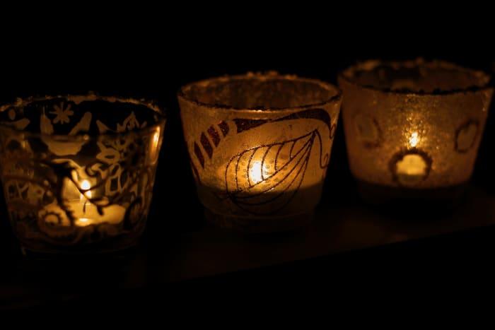 Small lit candles add a soft illumination.
