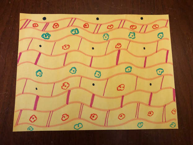 This is what the decorated construction paper looked like before being made into a cone.