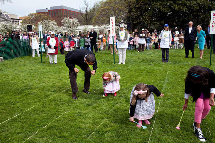 Barack Obama egg rolling on the White House lawn