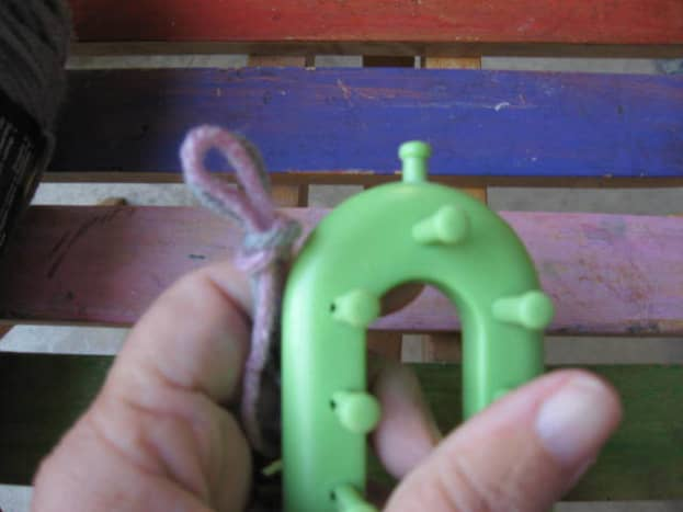 Using two plies of worsted weight yarn as if they are one, form slip knot.