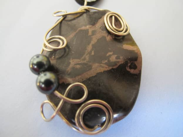 Black marble with silver wire wrap and blue Swarovski crystal pearls