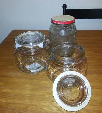 You can use jars from food you have finished or you can buy jars. Pictured here are a pickle jar and two dollar store mason jars.