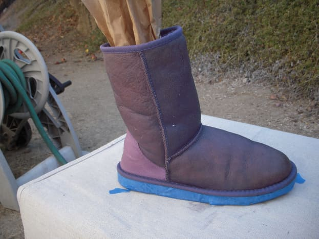 Step 4: Dye the boots. Put the newspaper or brown paper into your boots to keep them from flopping over while you work.