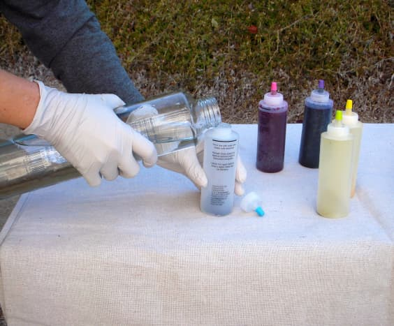 Step 3: Mix the dye. Add water to each dye bottle to fill line. Shake vigorously until no powder is visible at the bottom of the dye bottle.