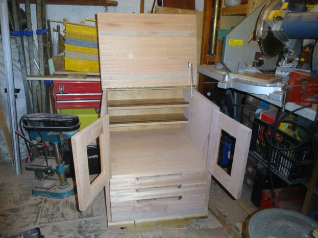 Two adjustable shelves (with front lips) made from recycled oak flooring, tested fitted in back of cabinet
