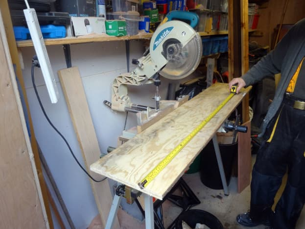 Plywood for the jig base being measured and cut to size