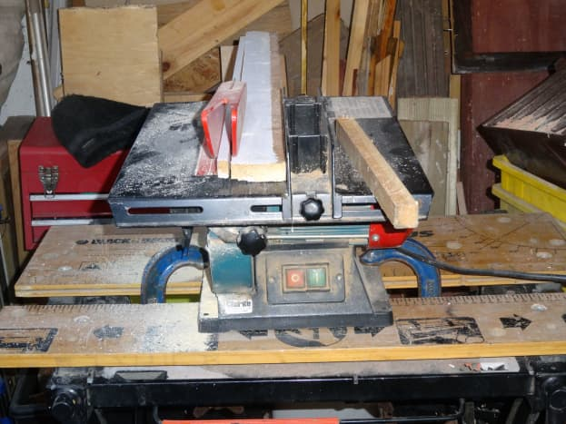 Cutting scrap wood to size for the sides of the housing for the plinth drawer