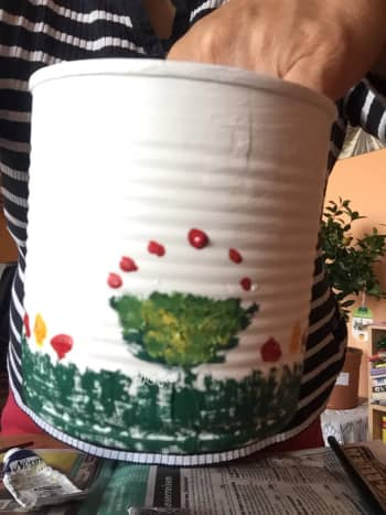 The golden oil paint was added to the green of the painted flower pots. Red dots were added on top of the pots.