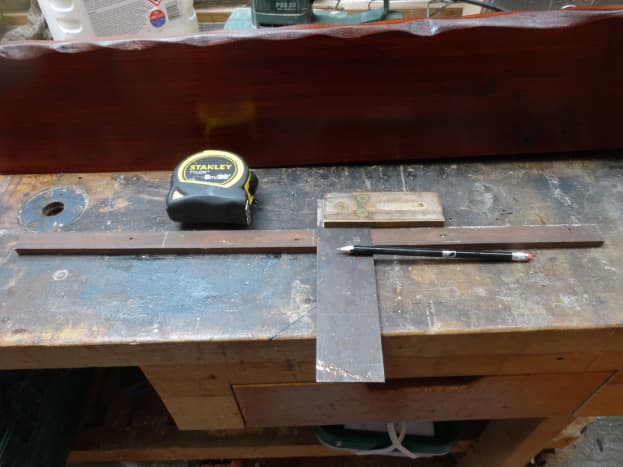 Measuring and marking out salvaged beading for recycling as shelf supports.