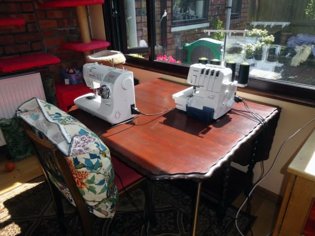 Repurposed table in situ, in our conservatory, with sewing machine and overlocker out and ready for use.