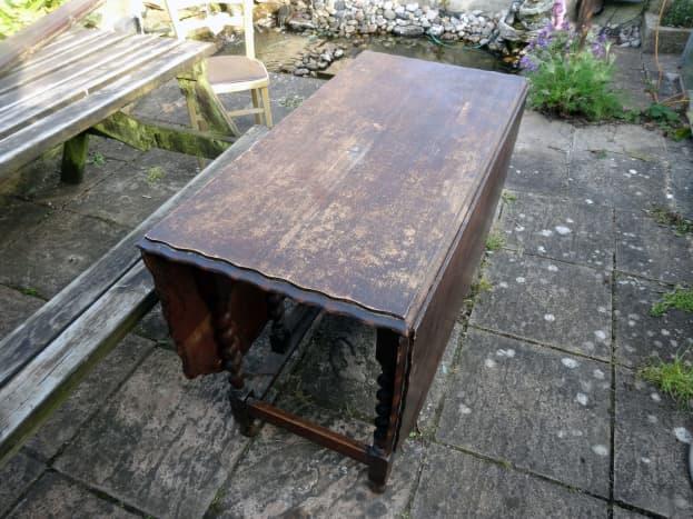 Oak table in poor state of repair.